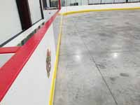 We traveled to Kapolei, Hawaii and inside to resurface two inline skate hockey rinks with Versacourt Speed Indoor tile. This is a closeup of the untiled floor before we started installing the Versacourt sport surface.