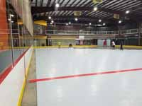 We traveled to Kapolei, Hawaii and inside to resurface two inline skate hockey rinks with Versacourt Speed Indoor tile. This shows installation of tiles in progress from another direction.