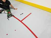 We traveled to Kapolei, Hawaii and inside to resurface two inline skate hockey rinks with Versacourt Speed Indoor tile. This is a look at the painstaking process of adding hockey court lines that couldn't be manufactured in.