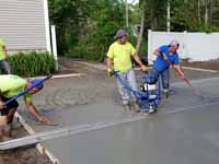 Residential slate green and red basketball court in Norwell, MA. Putting in cement for concrete court base.