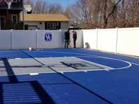 Royal blue and ice blue basketball court in Revere, MA. This was installed on existing concrete that included a cap on a filled in pool.