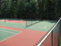 Restoration and resurfacing of large tennis court into multicourt with pickleball, hopscotch and shuffleboard for a condo complex in Duxbury, Massachusetts. Also visible here is an area lined for pickleball and equipped with net posts.