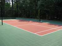 Restoration and resurfacing of large tennis court into multicourt with hopscotch and shuffleboard for a condo complex in Duxbury, Massachusetts. Focus here on the pickleball court area.
