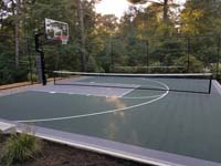 Backyard basketball court is the sort of thing you might find in Andover, MA or a yard like yours.
