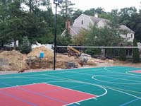 Backyard basketball courts like this multi-sport surface in Pembroke, MA can be yours in Massachusetts locations like Southborough, Framingham, Marlborough, Hudson, Stow and Maynard.