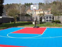 Light blue and red sport surface for basketball court in Beverly, MA.