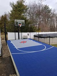 Blue  and grey backyard basketball court in Braintree, MA.