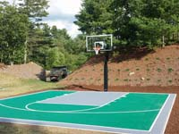 Backyard basketball court in Bridgewater, MA. We could install backyard basketball for you, too, in nearby Rhode Island locations like Bristol, Barrington, Portsmouth, Little Compton, and Central Falls.