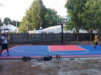 Backyard basketball court in Canton, MA. We could install backyard basketball for you, too, in nearby Rhode Island, like Cumberland, Lincoln, Pawtucket, East Providence, and Warren.