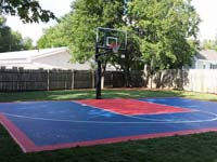 Backyard basketball court in Canton, MA. Whatever your sport, you could have a court surface and accessories of your own in North Reading, Chelmsford, Tewksbury, Wilmington or Billerica.