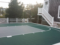 Backyard basketball court in Plymouth, MA. Whatever your sport, you could have a court surface and accessories of your own in Belmont, Holliston, Arlington, Wrentham or Saugus.