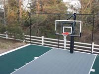 Backyard basketball court in Plymouth, MA. Whatever your sport, you could have a court surface and accessories of your own in Fairhaven, Hanson, Rockland, Berkley or Randolph.