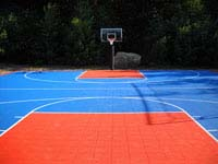 Large blue and orange backyard basketball court in Bellingham, MA.