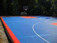 Full royal blue and orange residential basketball court installed in Bellingham, MA.
