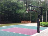 Basketball half court in Dartmouth, MA. Court can be parked on or driven over.