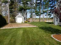 Backyard basketball court in Duxbury, MA. Volleyball, pickleball and Tennis are also available court options.