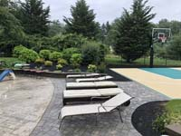 Easton, MA sand and green colored court after landscaping was completed by the owner.