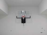 Basketball hoop installed in a garage. Basketball Courts of Massachusetts is your full service basketball court installation service in eastern Massachusetts and on Cape Cod.