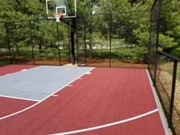 View of red and titanium home basketball court in Groton, MA.
