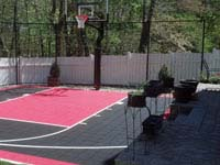 Small red and black basketball court in Hingham, MA.