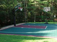 Backyard basketball court that doubles as tennis court in Kingston, MA