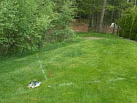 Before construction of backyard basketball court that doubles for tennis in Kingston, MA
