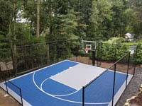 Residential basketball court in shades of blue in Lexington, MA.