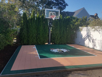 Backyard basketball court featuring Celtics logo and adjacent putting green by our partner is the sort of thing you might find in Manchester-by-the-Sea, MA or a yard like yours.