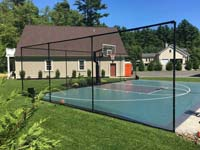 Green and graphite basketball court in Marion, MA. Distinctive appearance due to Versacourt Speed Outdoor tile used instead of the usual Game Outdoor.