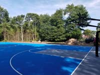 Commercial royal blue and titanium basketball court with golf seahorse logo at Bay Club in Mattapoisett, MA.