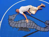 Bob loves this custom logo, and gives an idea of the scale of the image and large royal blue and titanium basketball court with golf seahorse logo at Bay Club in Mattapoisett, MA.