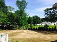 Construction begins on backyard basketball court with lights for night play in Massachusetts. This could be in Sherborn, Sudbury, Carlisle, Wayland, Brookline, or a happy backyard in your neighborhood.
