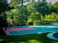 Backyard basketball court plus tennis net, with landscaping, patio and wall in Stoneham, MA.