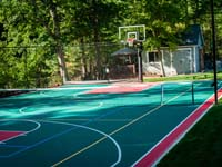 Backyard basketball court, landscaping, wall and patio in Stoneham, MA.