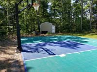 Jade green and blue Versacourt basketball tile on asphalt court in Rehoboth, MA.