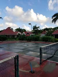 Sad Caribbean tennis court before restoration at Sandals Grande Antigua Resort and Spa in St. Johns, Antigua. Does your court look like this? Get it restored.