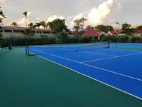 Large commercial Caribbean tennis court resurfacing project shown mostly done in St. John's, Antigua and Barbuda.
