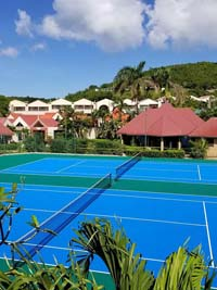 Caribbean tennis court restoration at Sandals Grande Antigua Resort and Spa in St. Johns, Antigua. This could be your resort's court, restored during our off season. It beats plowing snow.