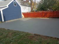 Backyard basketball court is the sort of thing you might find in Wakefield, MA or a yard like yours. Before the court surface is installed, preparing a quality base adds durability.