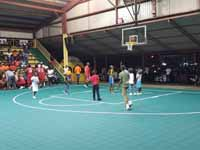 Resurfaced ABBA (Antigua and Barbuda Basketball Association) basketball court and replaced hoops at JSC Sports Complex in Piggotts, Antigua and Barbuda. Youngsters shooting hoops on new court before opening ceremonies.