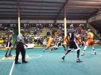 Resurfaced ABBA (Antigua and Barbuda Basketball Association) basketball court and replaced hoops at JSC Sports Complex in Piggotts, Antigua and Barbuda. Players and official in action during second game of season on new court surface.