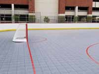 Side view of goal at one end of freshly built and surfaced outdoor inline hockey rink at Grand Canyon University in Phoenix, AZ.