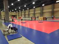 Indoor game tile volleyball courts for New England Regional Volleyball Association (NERVA) Winterfest 2020 tournament in Hartford, CT. Here's some of the court installation process.