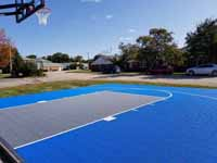 Royal blue and titanium basketball court for apartment complex residents in Dover, New Hampshire.