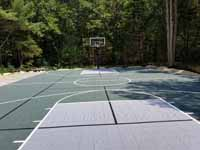 Large slate green and titanium basketball court in Easton, MA, with pickleball lines and shuffleboard.
