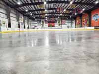 We traveled to Kapolei, Hawaii and inside to resurface two inline skate hockey rinks with Versacourt Speed Indoor tile. This is a view down the length of the first rink before construction bagan.