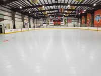 We traveled to Kapolei, Hawaii and inside to resurface two inline skate hockey rinks with Versacourt Speed Indoor tile. This is an after picture down much of the length of the first court.