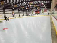 We traveled to Kapolei, Hawaii and inside to resurface two inline skate hockey rinks with Versacourt Speed Indoor tile. This is a picture of much of the court, not quite complete, with edges, a corner, and lines remaining.