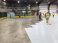 We traveled to Kapolei, Hawaii and inside to resurface two inline skate hockey rinks with Versacourt Speed Indoor tile. This shows tile installation in full swing.