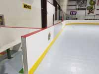 We traveled to Kapolei, Hawaii and inside to resurface two inline skate hockey rinks with Versacourt Speed Indoor tile. This is a detail view of one corner of the completed rink.